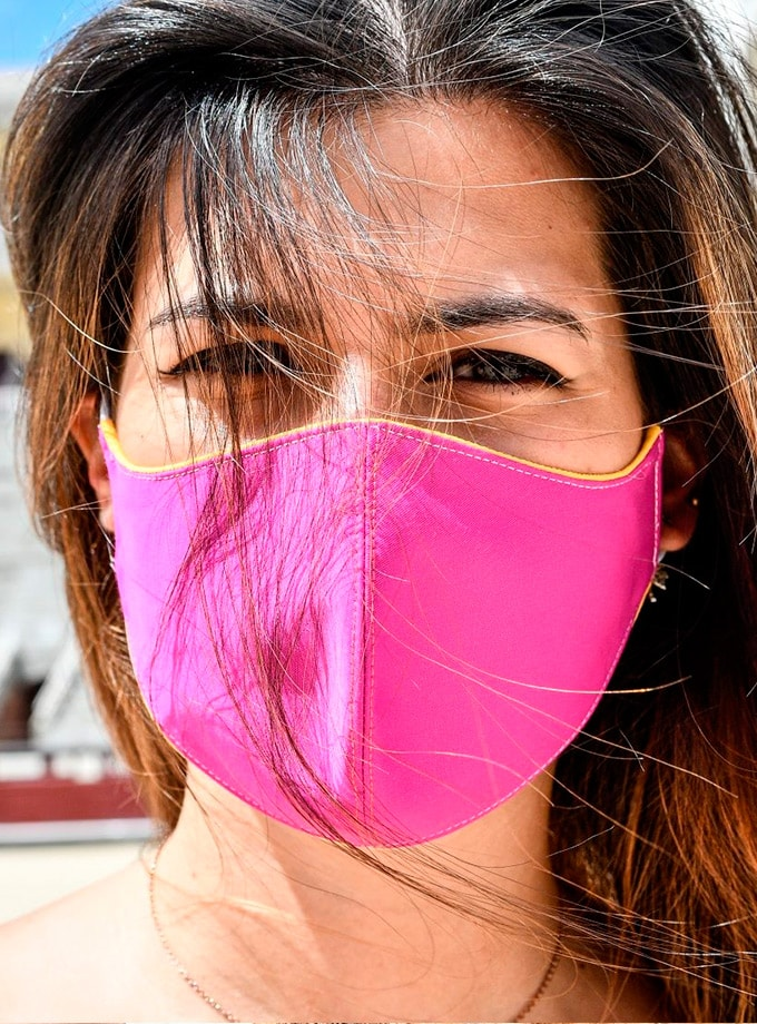 Facemask made with pink bullfighting cloth
